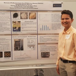 Channary next to her water project poster