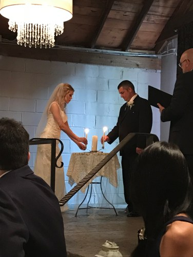Tara and Bill lighting their unity candle